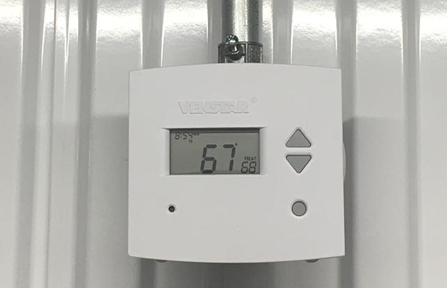 Commercial thermostat in building